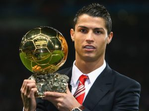 MANCHESTER, UNITED KINGDOM - DECEMBER 10: Cristiano Ronaldo of Manchester United receives the Ballon d'or after being voted the European Footballer of the Year before the UEFA Champions League Group E match between Manchester United and Aalborg at Old Trafford on December 10, 2008 in Manchester, England. (Photo by Alex Livesey/Getty Images)